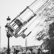 grayscale photo of empty swing rids